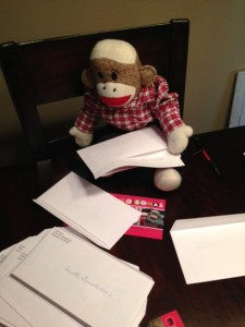 SMJ stuffing envelopes with Christmas cards for sailors