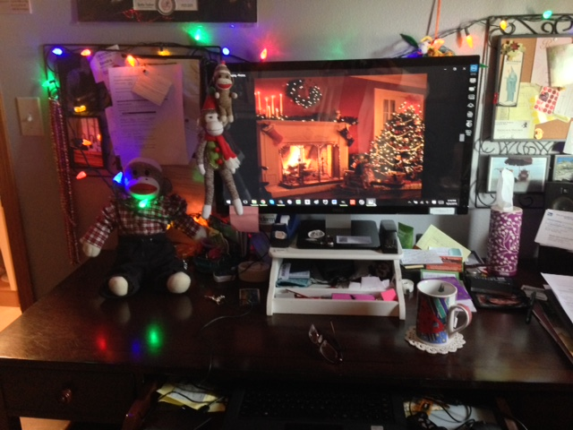 Sock Munkee with Christmas Decorations on desk